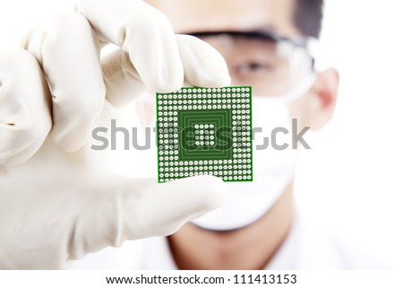 Scientist shows a microchip computer, shot in studio - stock photo