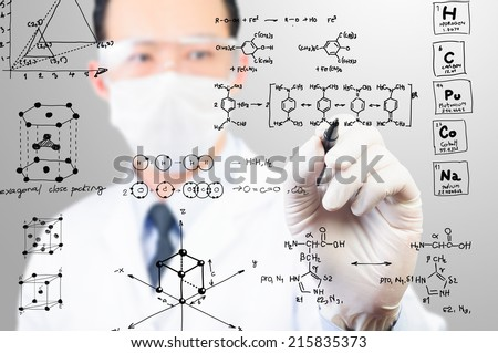 scientist sketching chemical formula - stock photo