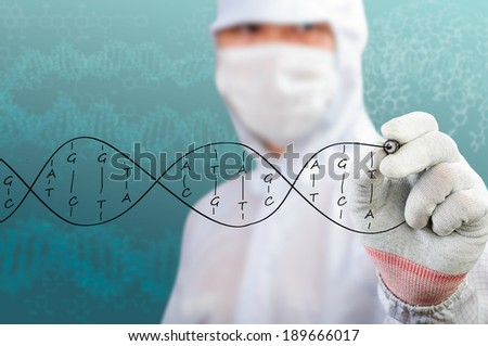 scientist sketching DNA structure - stock photo