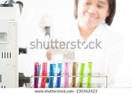 Scientist with working at the laboratory  - stock photo