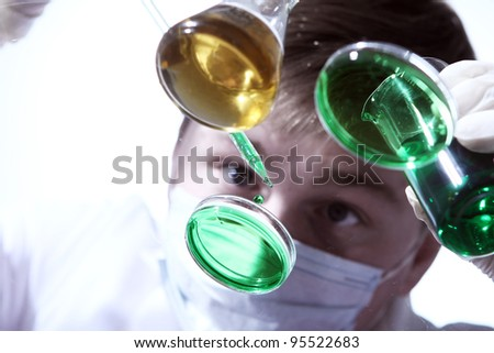 Scientist working in his  laboratory - stock photo
