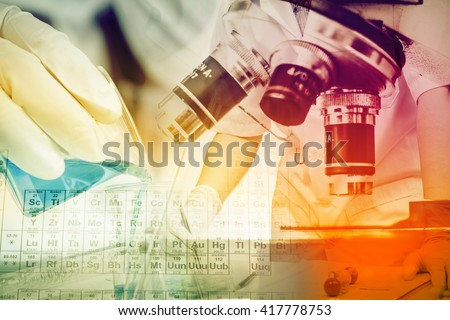 Scientists and scientific experiments to find out about the medical science or the scientific unit . The colors and scientific equipment beakers vitro microscopy . - stock photo