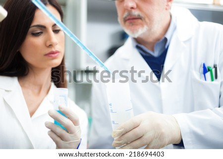 Scientists at work in a laboratory - stock photo