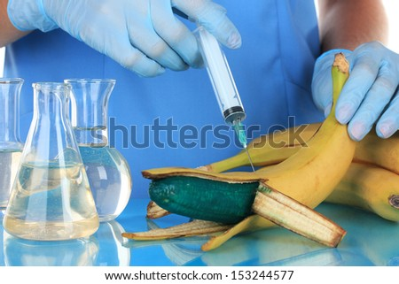 Scientists make injection into banana in laboratory - stock photo