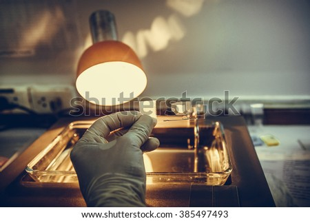 Scientists Slide tissue biopsy for diagnosis in pathology laboratory - stock photo