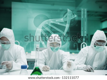 Scientists working in protective suite with futuristic interface showing DNA - stock photo