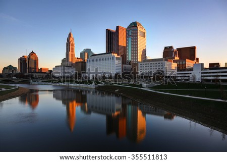 Scioto River and downtown Columbus Ohio skyline panoramic at dawn - stock photo