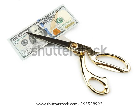 Scissors cut dollar banknote, isolated on white - stock photo