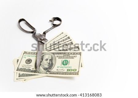 Scissors cuts dollars banknote on white background - stock photo