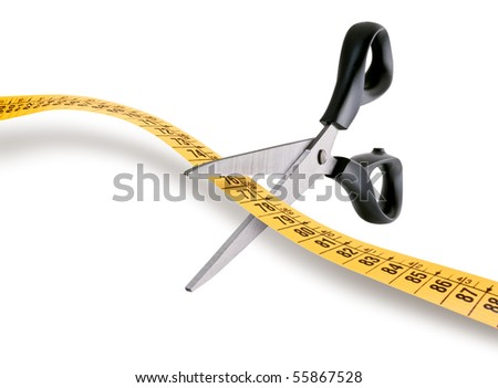 scissors cutting a measuring tape over white background - stock photo