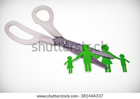 Scissors cutting paper cut of family / Broken family concept / divorce - stock photo