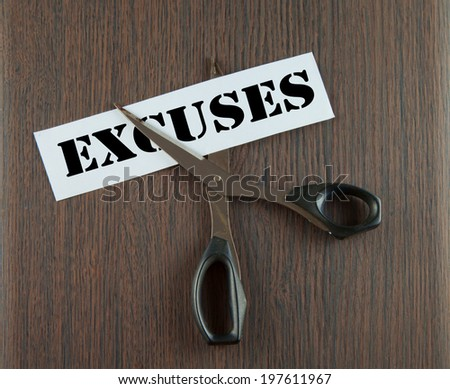"Scissors cutting the word ""Excuses"" written on a paper strip, over wooden background - stock photo"