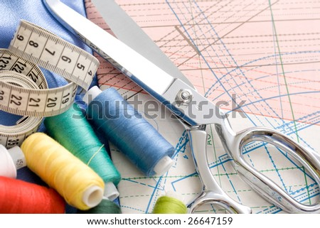 scissors, threads and measuring tape. shallow dof - stock photo