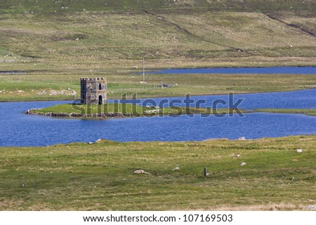 Scolpaig Tower (also known as D�¹n Scolpaig or MacLeodâ��s Folly) is a Georgian folly located near the village of Scolpaig on the Isle of North Uist in the Outer Hebrides. - stock photo