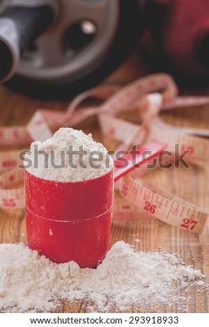Scoop of whey protein isolate powder - stock photo