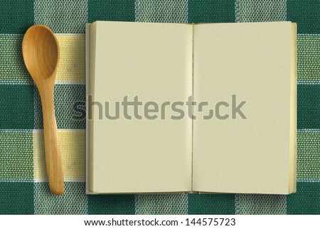 Scoop with blank opened book (Cookbook concept) - stock photo