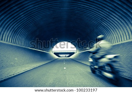 Scooter in tunnel - stock photo