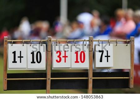 Scoreboard at a lawn bowls tournament - stock photo