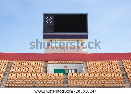 Scoreboard orange seat in stadium  - stock photo