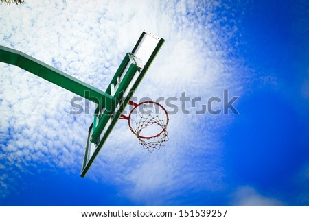 scoring basket in basketball court - stock photo