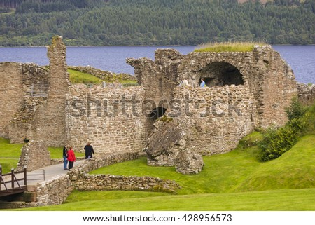 SCOTLAND - AUGUST 22, 2004: Ruins of Urquhart Castle on Loch Ness, in the Highlands. - stock photo
