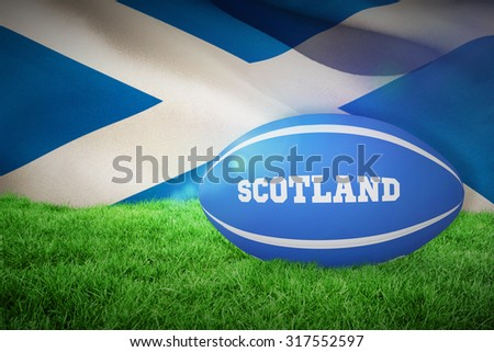 Scotland rugby ball against flag of scotland - stock photo