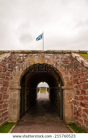 scottish flag over fort george gate - stock photo