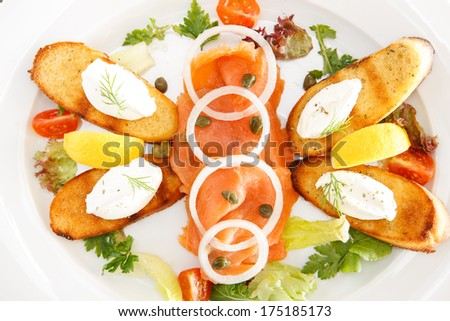 Scottish smoked salmon with cream cheese on toasted herb bruschetta - stock photo