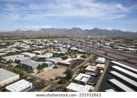 Scottsdale Airport with the McDowell Mountains in the distance - stock photo