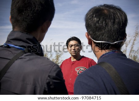 SCOTTSDALE, ARIZONA, USA – FEBRUARY 20: Takashi Saito of the Arizona Diamondbacks speaks with Japanese media on the first day of Spring Training in Phoenix Arizona on February 20 2012. - stock photo