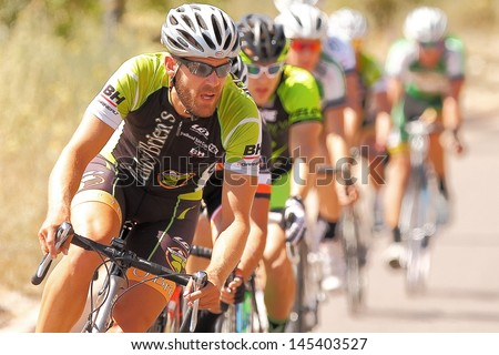 SCOTTSDALE, AZ - MAY 19: David Straus competes in the Criterium at DC Ranch, a high-speed circuit race on a 1-kilometer closed course on May 19, 2013 in Scottsdale, AZ.  - stock photo