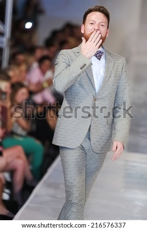 SCOTTSDALE, AZ - OCTOBER 3: Brandon McDonald on the runway after showcasing his collection during a runway show at the Phoenix Fashion Week at Talking Stick Resort on Oct. 3, 2013 in Scottsdale, AZ.  - stock photo