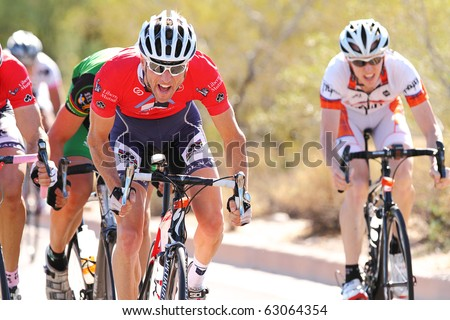 SCOTTSDALE, AZ - OCTOBER 3: Cyclists enjoy the 7th annual Tour de Scottsdale, a 70-mile charity bicycle race benefiting the McDowell Sonoran Conservancy on Sunday October 3, 2010 in Scottsdale AZ. - stock photo