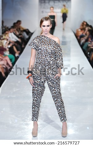 SCOTTSDALE, AZ - OCTOBER 3: Models showcasing designs from Black Russian Label collection during a runway show at the Phoenix Fashion Week at Talking Stick Resort on Oct. 3, 2013 in Scottsdale, AZ.  - stock photo