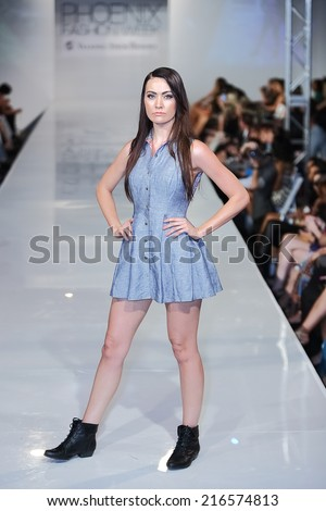 SCOTTSDALE, AZ - OCTOBER 3: Models showcasing designs from the Linden collection during a runway show at the Phoenix Fashion Week at Talking Stick Resort on October 3, 2013 in Scottsdale, AZ.  - stock photo
