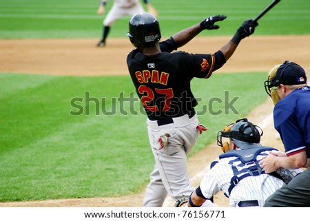 SCRANTON - JULY 31: Rochester Red Wings' Denard Span (No. 27) swings at a pitch in a game against the Scranton Wilkes Barre Yankees at PNC Field on July 31, 2008 in Scranton, PA. - stock photo