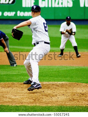 SCRANTON - JULY 31: Scranton Wilkes Barre Yankees pitcher Phil Hughes delivers a pitch in a game at PNC Field July 31, 2008 in Scranton, PA. - stock photo