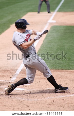 SCRANTON, PA - AUGUST 24: Rochester Red Wings batter Dustin Martin swings at a pitch during a game against the Scranton Wilkes Barre Yankees at PNC Field on August 24, 2011 in Scranton, PA. - stock photo