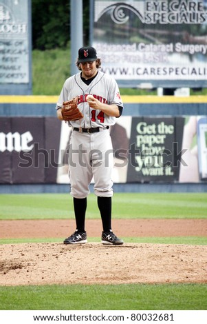 SCRANTON, PA - MAY 24: Indianapolis Indians pitcher Daniel Moskos looks at the baseball in a game against the Scranton Wilkes Barre Yankees at PNC Field on May 24, 2011 in Scranton, PA. - stock photo