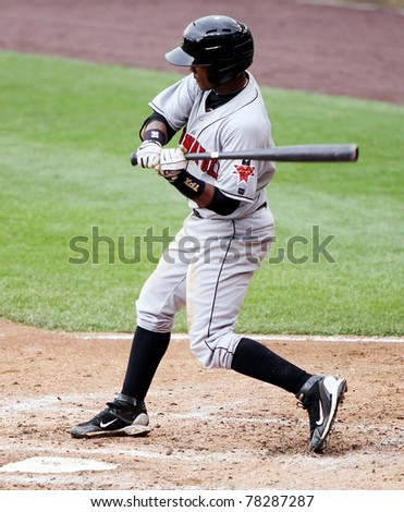 SCRANTON, PA - MAY 24:Indianapolis Indians shortstop Pedro Ciriaco checks his swing in a game against the Scranton Wilkes Barre Yankees at PNC Field on May 24, 2011 in Scranton, PA. - stock photo