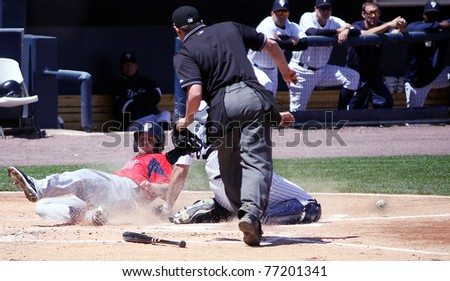 SCRANTON, PA - MAY 8: Pawtucket Red Sox Drew Sutton is safe at home plate as the ball dribbles away from Jesus Montero against the Scranton Yankees at PNC Field on May 8, 2011 in Scranton, PA. - stock photo