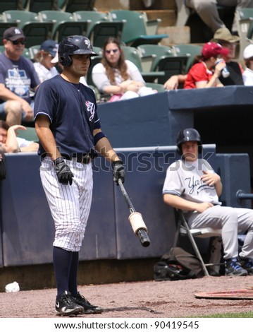 SCRANTON, PA - MAY 24: Scranton Wilkes Barre Yankees batter Jesus Montero warms up during a game against the Indianapolis Indians at PNC Field on May 24, 2011 in Scranton, PA. - stock photo
