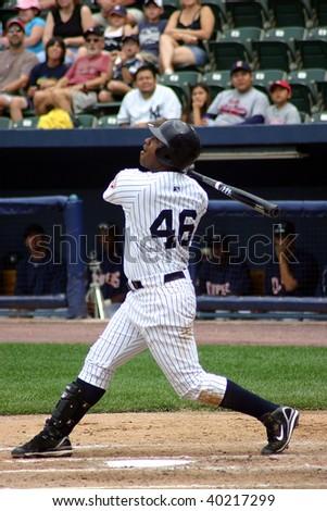 SCRANTON PENNSYLVANIA - JUNE 26: Scranton Wilkes Barre Yankees batter Juan Miranda swings at a pitch against the Columbus Clippers in a game at PNC Field June 26, 2008 in Scranton, PA. - stock photo