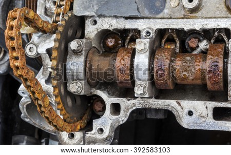 Scrap Auto Car parts. Rusty timing cam shaft on old engine block. - stock photo