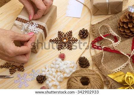 scrapbook background. christmas - girl packs gift  - stock photo