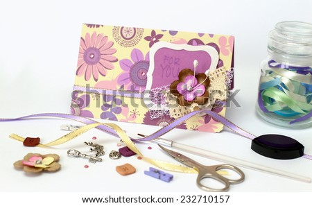 scrapbook. Card and tools with decoration on white background  - stock photo