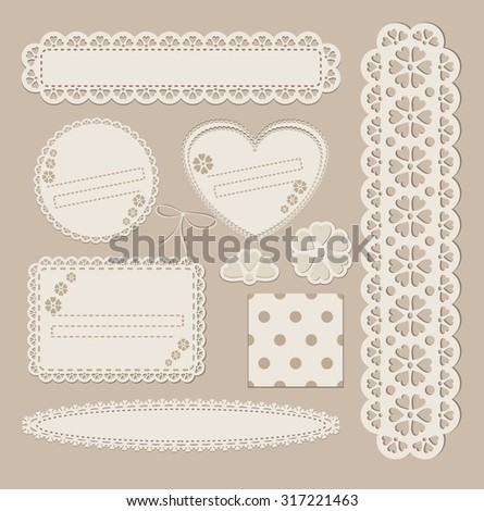 Scrapbook set with different elements - scrapbook paper, lace, postcard, stamp, frame, paper cut heart, ribbon. - stock photo