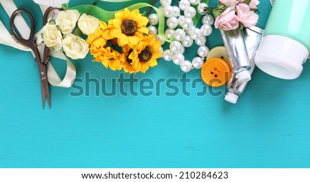 Scrapbooking craft materials on color wooden background - stock photo