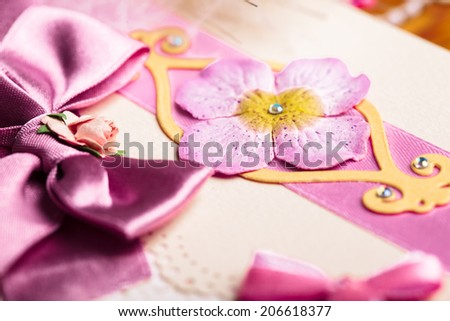Scrapbooking wedding invitation postcard, close up details - stock photo