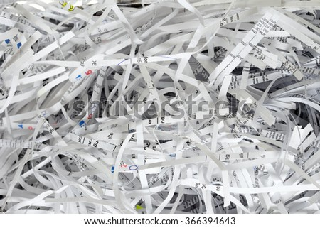 Scraps of paper from a paper shredder / Scraps of paper - stock photo